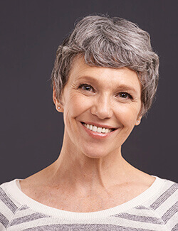 woman with grey hair smiling