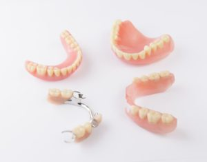 Group of partials and full dentures in Marshall